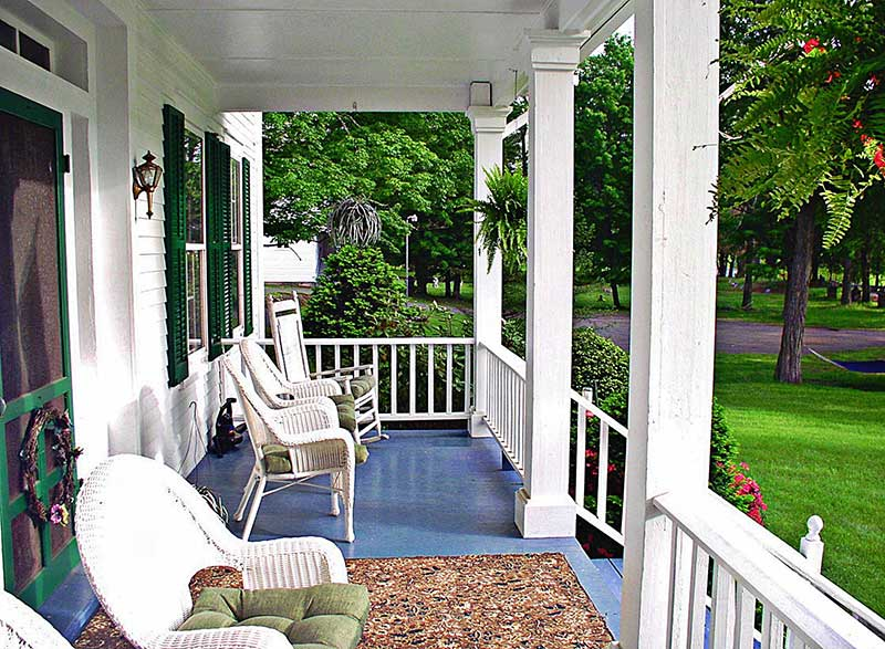 1870-Roebling-Inn-On-The-Delaware-front-porch rocking chairs trees