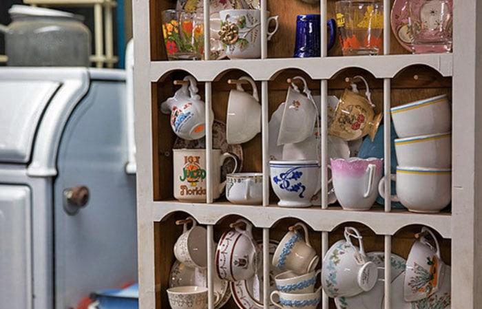 cabinet of assorted vintage dishware