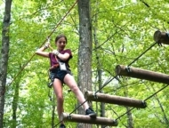adventure center at skytop lodge girl on logs zip lining