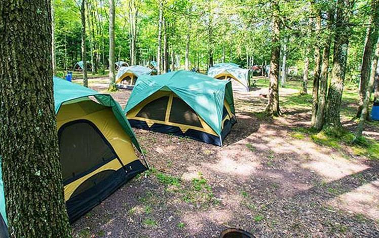 Campground-at-Whitewater-Challengers-tents-woods