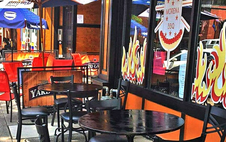 Churrasqueria-La-Morena-BBQ-tables-on-sidewalk