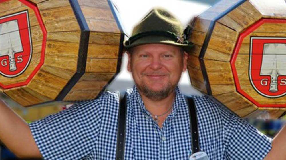 Oktoberfest at Blue Mountain PHOTO of man holding wooden kegs