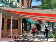 sidewalk tables with awning over top