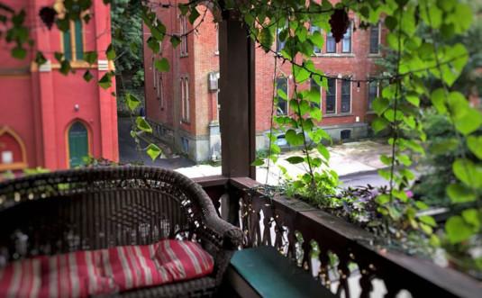 Gilded Cupid B&B Jim Thorpe-wicker-divan-on-porch