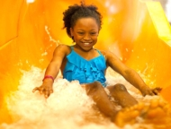 great wolf water park little girl on orange water slide
