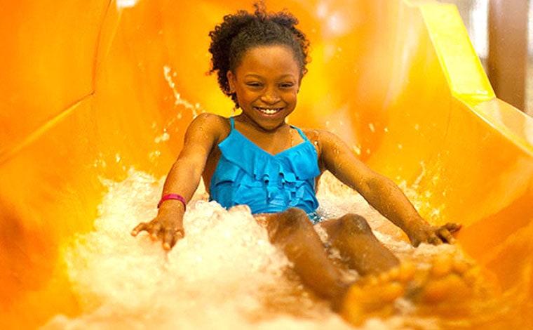 great wolf water park little girl on orange water slide
