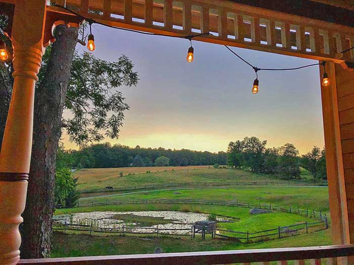 view of pond and pasture from the porch