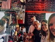 bartender and people sitting at bar