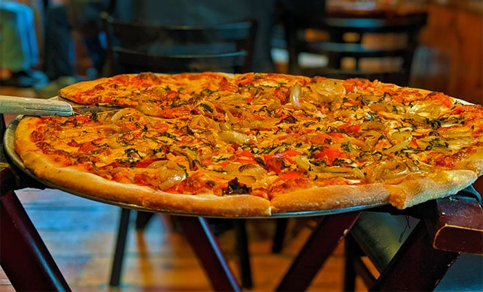 large pizza on serving tray