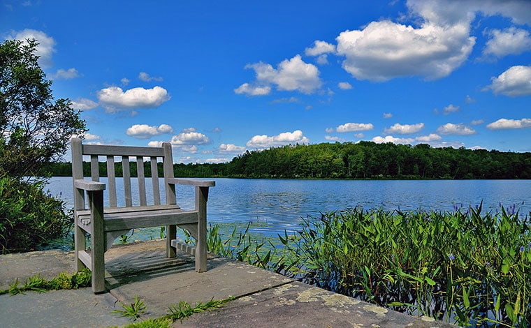 chair on the shore of lake wallenpaupack