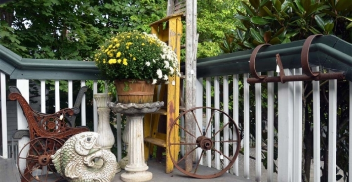 Old-Lumberyard-Antiques-porch-with-wagon-wheel-
