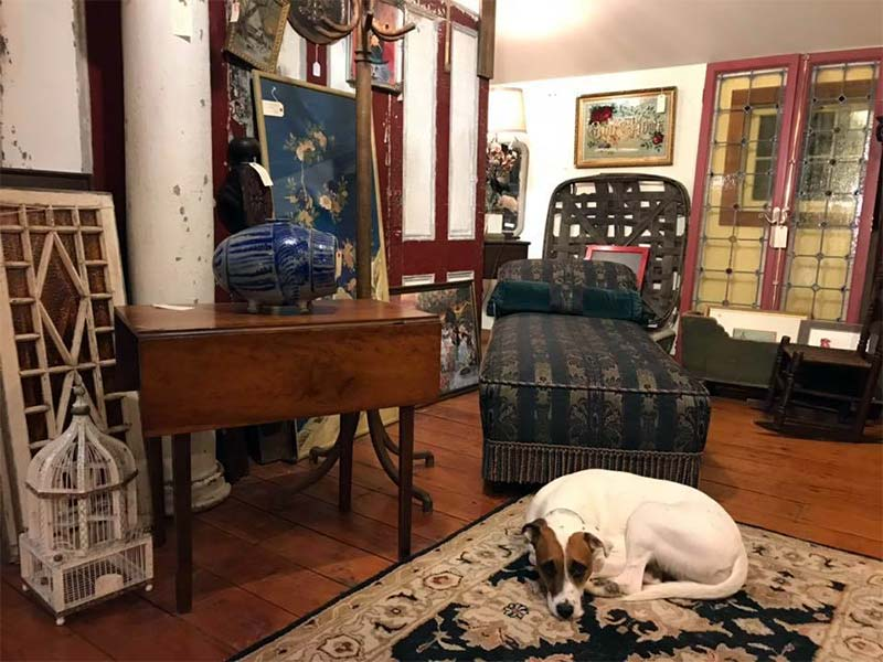 Old-Lumberyard-Antiques-shop-with-birdcage-and-settee