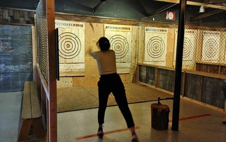 woman throwing axe