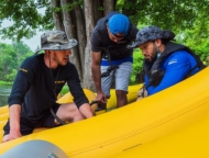 Silver Canoe and Whitewater Rafting 3 guys in a raft