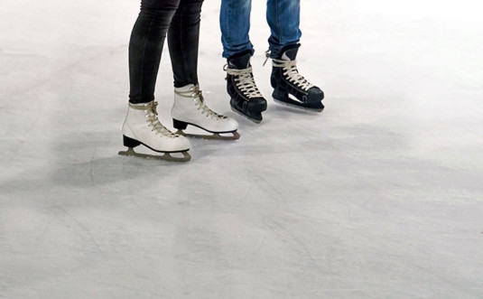 skytop lodge skating couples with skates on ice