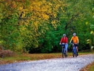 couple biking on the switchback trail in autumn