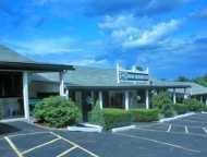 exterior of hotel in parking lot