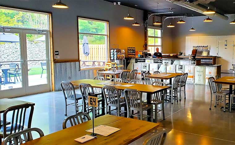 Wake Zone Indoor Golf + Taproom tables and the bar