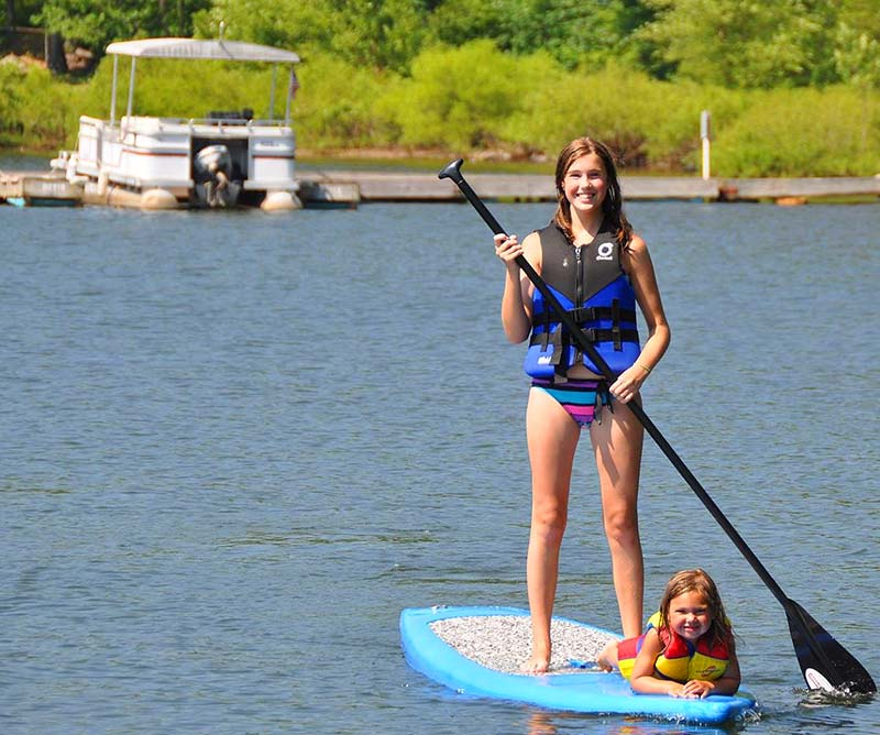 wallenpaupack boat tours and rentals girl on paddleboard