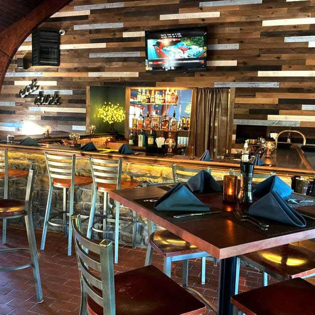 tables in front of bar