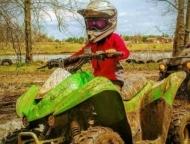 child on atv trail