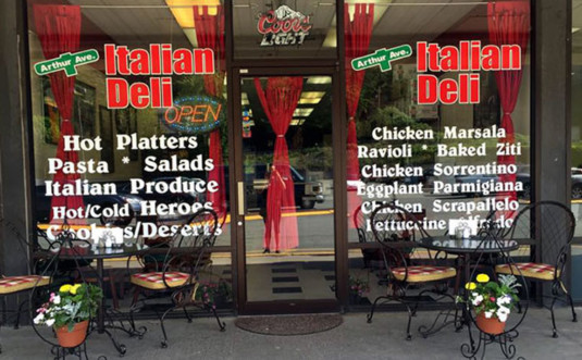 arthur-avenue-italian-deli-storefront-window-wiht-hand-painted-menu