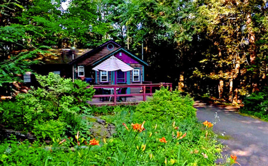 babbling-brook-cottages-edge-of-woods-with-deck-and-tiger-lillies