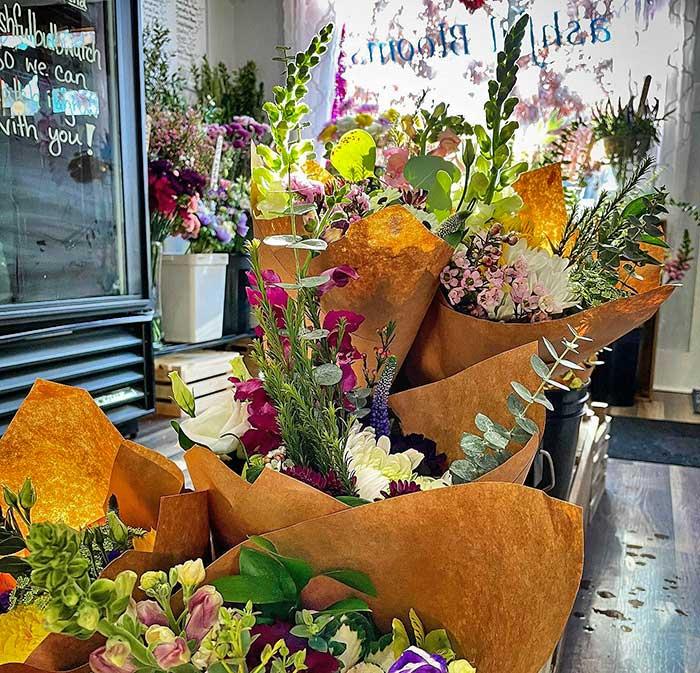 shop interior with flower bundles on shelves