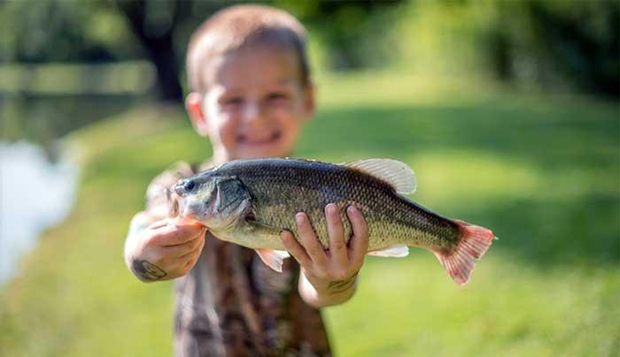 big-brown-fish-&-pay-lakes-child-holding-fish