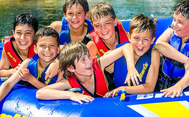 camp-starlight-boys-on-lake-in-a-tube