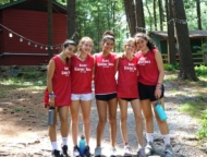 camp-timber-tops-girls-friends-in-front-of-cabins