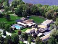 https://gopoconomountains.com/wp-content/uploads/central-house-family-resort-aerial-view-buildings-and-lake.jpg