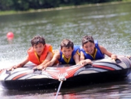 chesnut-lake-camp-boys-in-a-tube-raft