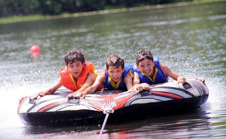 chesnut-lake-camp-boys-in-a-tube-raft