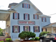 exterior of country kettle giant old white house