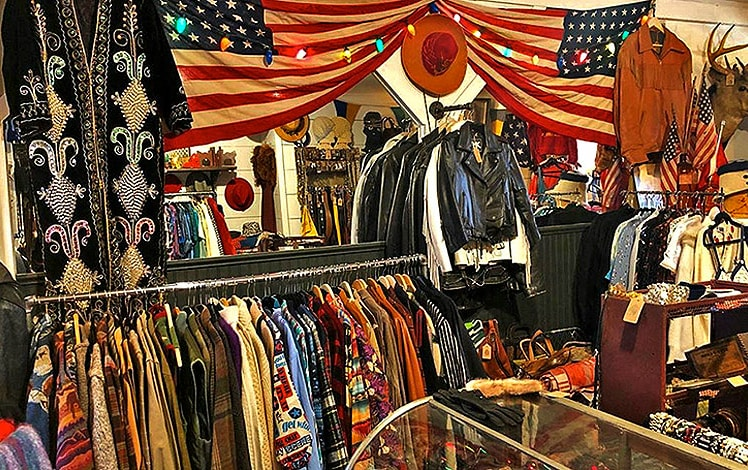 racks of clothes inside store