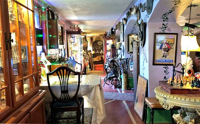 the hallway is jam packed with antiques