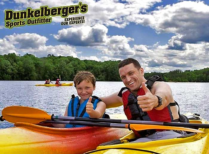 man and son in kayaks