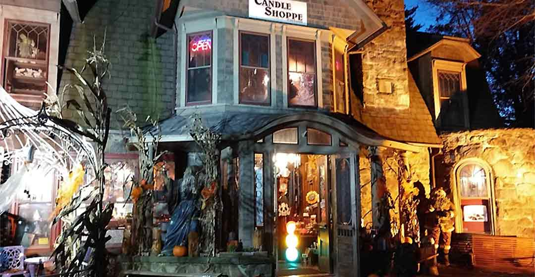 The Haunted Candle Shoppe of the Poconos exterior of building at night