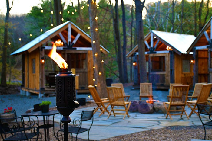 cabins and fire pit in grant's woods
