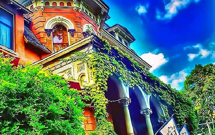 harry packer mansion front porch covered in ivy