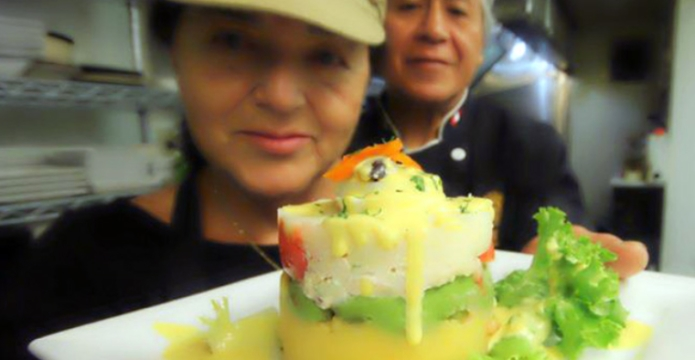inti-peruvian-cuisine- owners and chef behind the cooking line