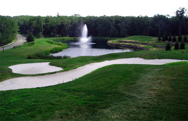jack-frost-national-golf-course-ond-and-waterfall-with-sand-traps