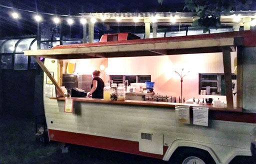 kc pepper bar and grill outdoor bar in vintage trailer