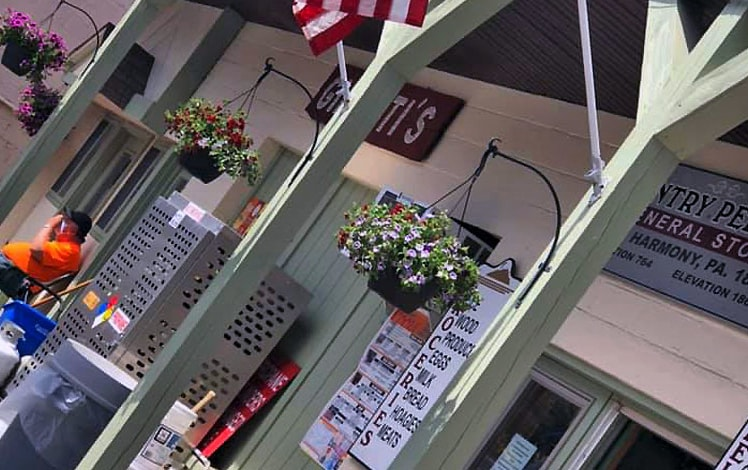 lake-harmony-country-store-exterior with flags and hanging flower baskets