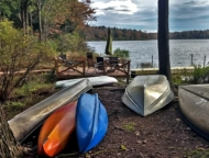 canoes stored on river shore