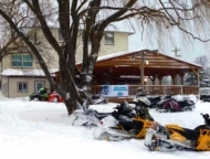 restaurant exterior in the now, deck and snowmobiles