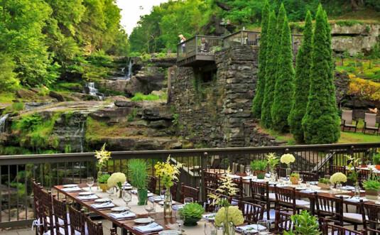 wedding tables on deck overlooking waterfall