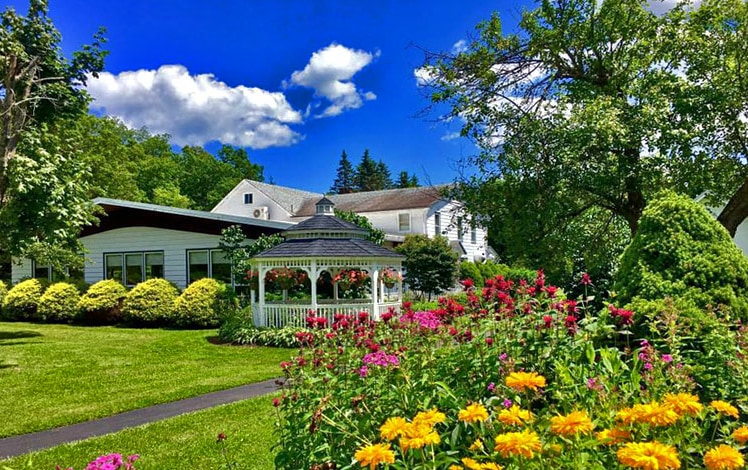 exterior of Lukan's Farm Resort main building and flower garden