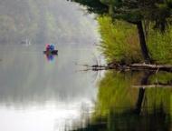 couple fishing on a foggy lake